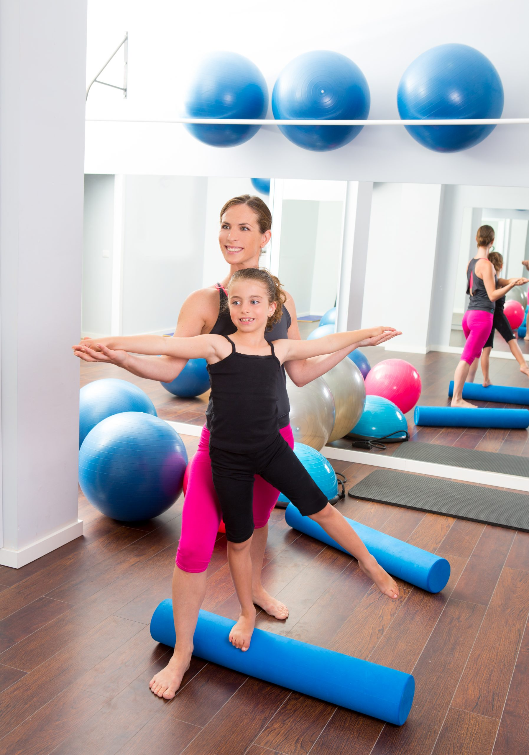 Aerobics,Woman,Personal,Trainer,Of,Children,Girl,Stability,With,Foam